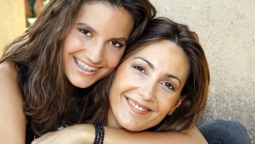 Teen Hugging Her Mother